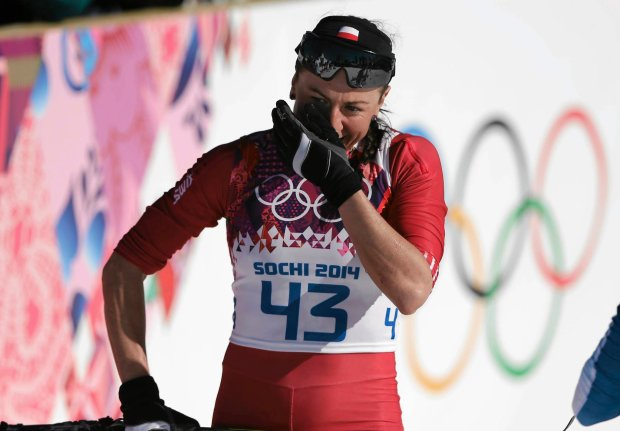 Poland's Justyna Kowalczyk cries after winning the gold during the women's 10K classical-style cross-country race at the 2014 Winter Olympics, Thursday, Feb. 13, 2014, in Krasnaya Polyana, Russia. (AP Photo/Matthias Schrader) SLOWA KLUCZOWE: 2014 Sochi Olympic Games;Winter Olympic games;Olympic games;Sports;Events;XXII Olympic Winter Games