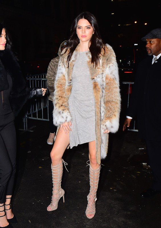 0Kendall and Kylie Jenner were spotted cozying up outside of their NYFW Launch party in Tribeca on Monday. The cute sisters giggled as they hugged each other while posing for photos outside the party. They wore their own Kendall + Kylie Clothing , with the addition of fur coats.  Pictured: Kendall Jenner