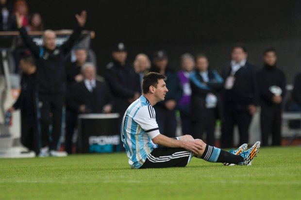 Argentina's Lionel Messi reacts after being fouled during an international friendly soccer match against Slovenia in La Plata, Argentina, Saturday, June 7, 2014. Argentina is leaving June 9 for Brazil to compete in the World Cup. (AP Photo/Eduardo Di Baia)
