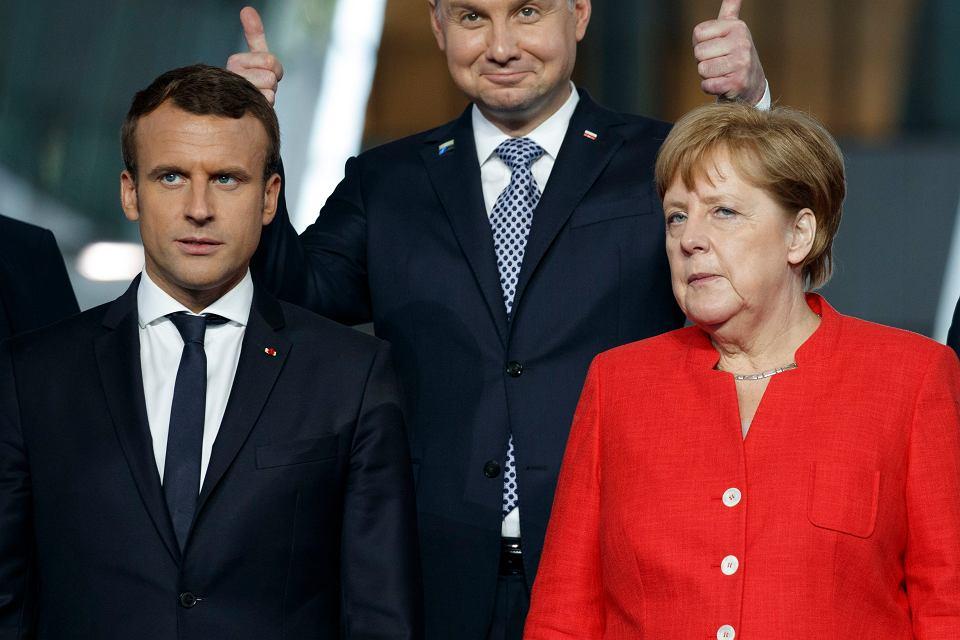 https://bi.gazeta.pl/im/7e/da/14/z21864574V,Prezydent-Francji-Emmanuel-Macron-i-kanclerz-Niemi.jpg