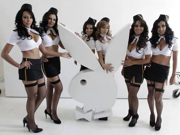 Six former air hostesses of Mexicana Airlines pose during a news conference before taking part in a private session for Playboy magazine in Mexico City February 7, 2011. Heavily indebted Mexicana, one of the world's oldest airlines, suspended all flights in August 2010 but plans to resume operations in 2011. REUTERS/Henry Romero (MEXICO - Tags: TRANSPORT SOCIETY ENTERTAINMENT)