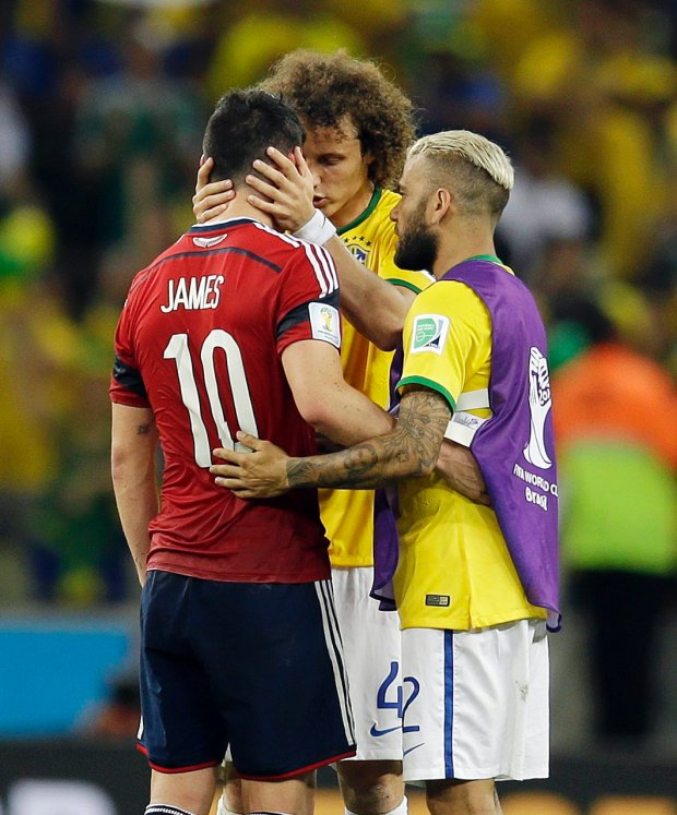 Colombia's James Rodriguez is consoled by Brazil's David Luiz and Dani Alves, right, after the World Cup quarterfinal soccer match between Brazil and Colombia at the Arena Castelao in Fortaleza, Brazil, Friday, July 4, 2014. Brazil defeated Colombia 2-1 to advance to the semifinals. (AP Photo/Natacha Pisarenko)