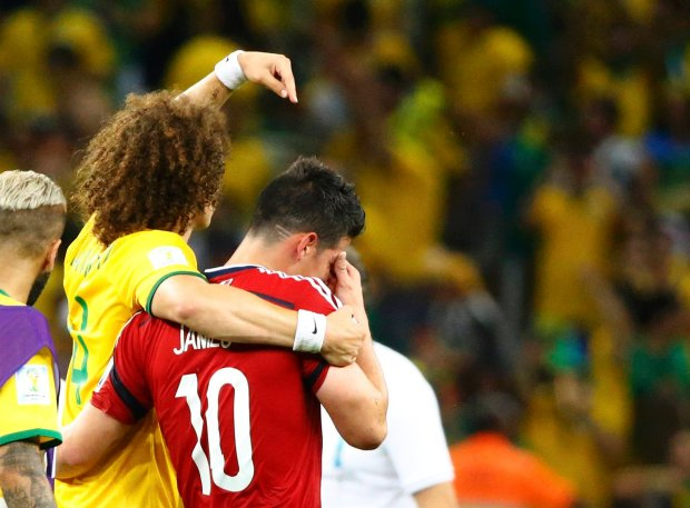 Brazil's David Luiz acknowledges Colombia's James Rodriguez at the end of their 2014 World Cup quarter-finals at the Castelao arena in Fortaleza July 4, 2014. REUTERS/Stefano Rellandini (BRAZIL  - Tags: SOCCER SPORT WORLD CUP)
