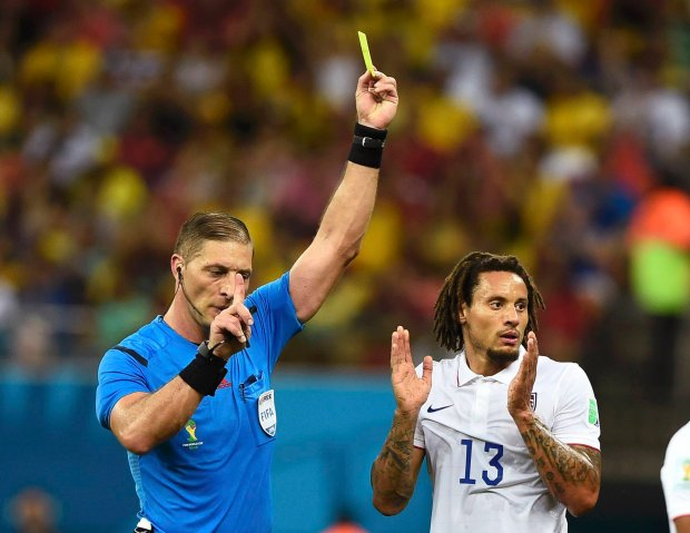 Jermaine Jones of the U.S. is shown the yellow card by referee Nestor Pitana of Argentina during their 2014 World Cup G soccer match against Portugal at the Amazonia arena in Manaus June 22, 2014. REUTERS/Dylan Martinez (BRAZIL  - Tags: SOCCER SPORT WORLD CUP)