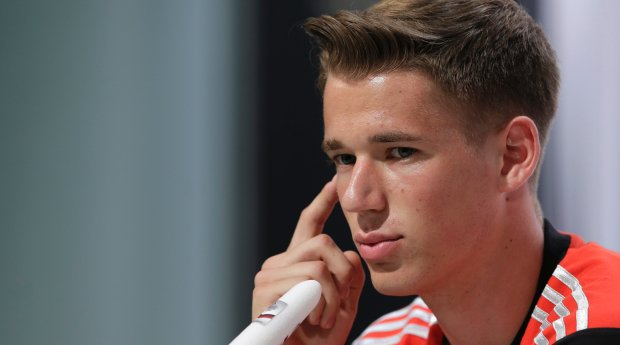 Germany's national soccer player Erik Durm attends a news conference in Santo Andre near Porto Seguro, Brazil, Friday, June 13, 2014. Germany will play in group G of the 2014 soccer World Cup. (AP Photo/Matthias Schrader)