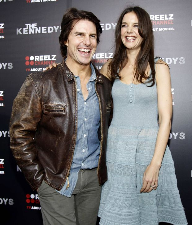 Actor Tom Cruise poses with his wife and cast member Katie Holmes at the premiere of the television series