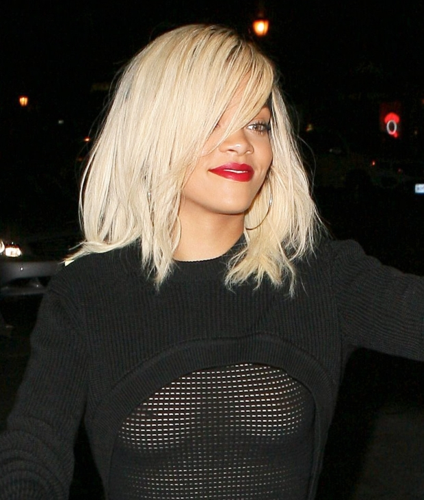 Rihanna in a see though sweater ad no bra leaving dinner March 11, 2012 X17online.com *** Local Caption ***  Rihanna