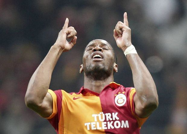 Galatasaray's Didier Drogba celebrates after scoring a goal against Real Madrid during their Champions League quarter-final second leg soccer match in Istanbul April 9, 2013.           REUTERS/Osman Orsal (TURKEY  - Tags: SPORT SOCCER)