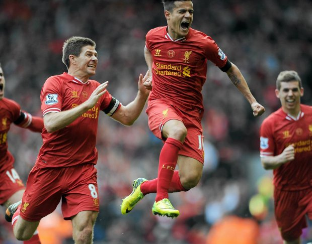Liverpool's Philippe Coutinho right, celebrates with team-mate Steven Gerrard left, after he scores the third goal of the game for his side during their English Premier League soccer match against Manchester City at Anfield in Liverpool, England, Sunday April. 13, 2014. (AP Photo/Clint Hughes)   SLOWA KLUCZOWE: xpremierleaguex
