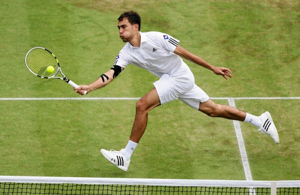 Jerzy Janowicz of Poland returns to Lukasz Kubot of Poland during their Men's singles quarterfinal match at the All England Lawn Tennis Championships in Wimbledon, London, Wednesday, July 3, 2013.(AP Photo/Kirsty Wigglesworth)