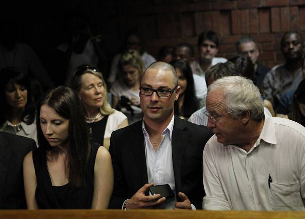 Oscar Pistorius' sister Aimee, brother Carl and father Henke await the start of court proceedings in the Pretoria Magistrates court February 20, 2013.
