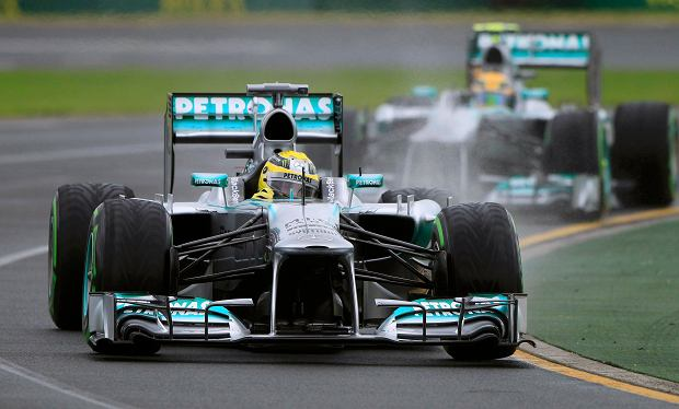 Mercedes Formula One driver Nico Rosberg of Germany drives in front of teammate Lewis Hamilton of Britain during the qualifying session of the Australian F1 Grand Prix at the Albert Park circuit in Melbourne March 17, 2013. REUTERS/Scott Wensley (AUSTRALIA  - Tags: SPORT MOTORSPORT F1)