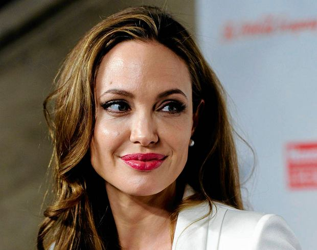 FILE - This March 8, 2012 file photo shows actress Angelina Jolie at the Women in the World Summit in New York. Jolie says that she has had a preventive double mastectomy after learning she carried a gene that made it extremely likely she would get breast cancer. The Oscar-winning actress and partner to Brad Pitt made the announcement in  an op-ed she authored for Tuesday's New York Times under the headline,