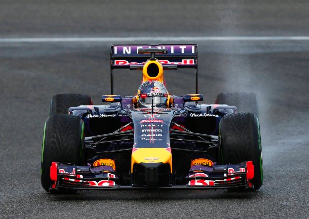 Red Bull Formula One driver Sebastian Vettel of Germany drives his RB10 during pre-season testing at the Jerez racetrack in southern Spain January 29, 2014. Formula One may have to 'revisit' a controversial rule change awarding double points for the final race of the season because of the backlash from fans, according to Mercedes motorsport head Toto Wolff.  REUTERS/Marcelo del Pozo (SPAIN - Tags: SPORT MOTORSPORT)