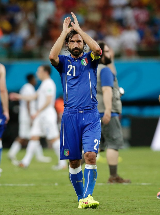 Italy's Andrea Pirlo applauds after Italy's 2-1 victory over England in their group D World Cup soccer match at the Arena da Amazonia in Manaus, Brazil, Saturday, June 14, 2014.  (AP Photo/Marcio Jose Sanchez)