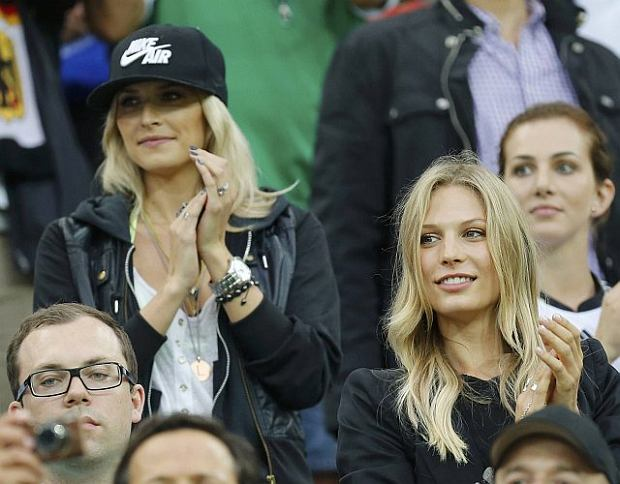 Lena Gercke (L) the girlfriend of Germany's national soccer player Sami Khedira, Sarah Brandner (C) the girlfriend of Bastian Schweinsteiger and Lisa (R) the girlfriend of Thomas Mueller wait for the start of the Euro 2012 quarter-final soccer match between Greece and Germany at the PGE Arena in Gdansk June 22, 2012.     REUTERS/Thomas Bohlen (POLAND  - Tags: SPORT SOCCER)