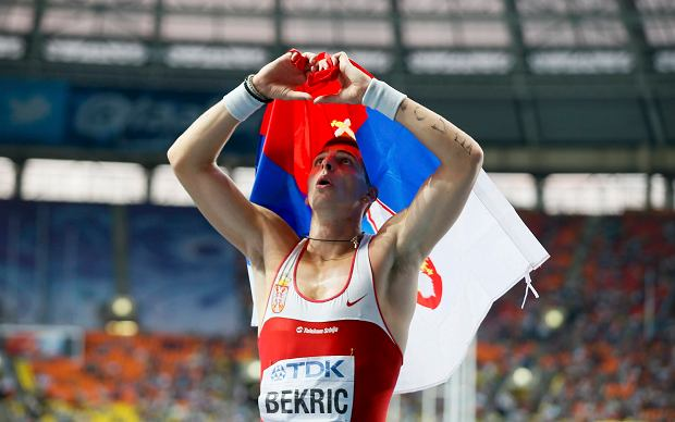 Third placed Emir Bekric of Serbia celebrates after the men's 400 metres hurdles final of the IAAF World Athletics Championships at the Luzhniki Stadium in Moscow August 15, 2013.                        REUTERS/Lucy Nicholson (RUSSIA  - Tags: SPORT ATHLETICS)