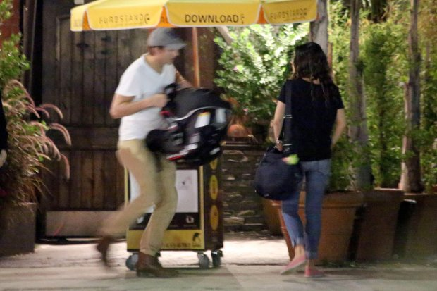 =*EXCLUSIVE* **WEB EMBARGO UNTIL 7AM PST 10/28/14** Sherman Oaks, CA - New parents Mila Kunis and Ashton Kutcher take their newborn daughter Wyatt out to The Gadarene Swine where they met up with a couple of friends.  Mila showed off her post-baby body and kept her look simple in a black tee with capri jeans and red slip on shoes.  Ashton carried his daughter in a baby carrier and safely put her inside the car.  After the group chatted outside, they said their goodbyes and went their separate ways.**SHOT ON 10/24/14**AKM-GSI          October 24, 2014To License These Photos, Please Contact :Steve Ginsburg(310) 505-8447(323) 423-9397steve@akmgsi.comsales@akmgsi.comorMaria Buda(917) 242-1505mbuda@akmgsi.comginsburgspalyinc@gmail.com *** Local Caption ***  Mila Kunis and Ashton Kutcher