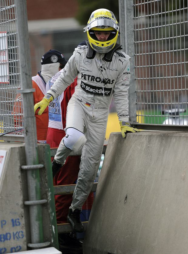 Mercedes driver Nico Rosberg of Germany leaves the track after an engine failure caused him to retire early from the race during the Australian Formula One Grand Prix at Albert Park in Melbourne, Australia, Sunday, March 17, 2013. (AP Photo/Andrew Brownbill)