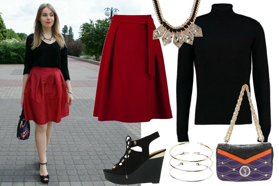 Julita Buczek, czerwona spódnica, czarny sweter, duży naszyjnik