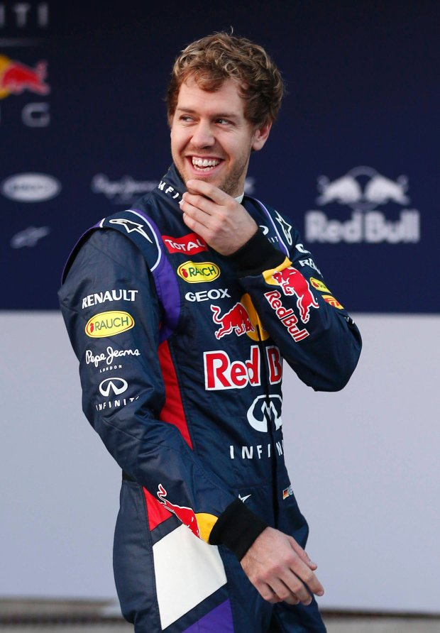 Red Bull Formula One driver Sebastian Vettel of Germany smiles after unveiling the new RB10 during the official presentation of the Red Bull Formula One Team 2014 at the Jerez racetrack in southern Spain January 28, 2014. Formula One world champions Red Bull and closest rivals Mercedes unveil their 2014 cars before the start of pre-season testing and a new V6 turbo era. REUTERS/Marcelo del Pozo (SPAIN - Tags: SPORT MOTORSPORT)