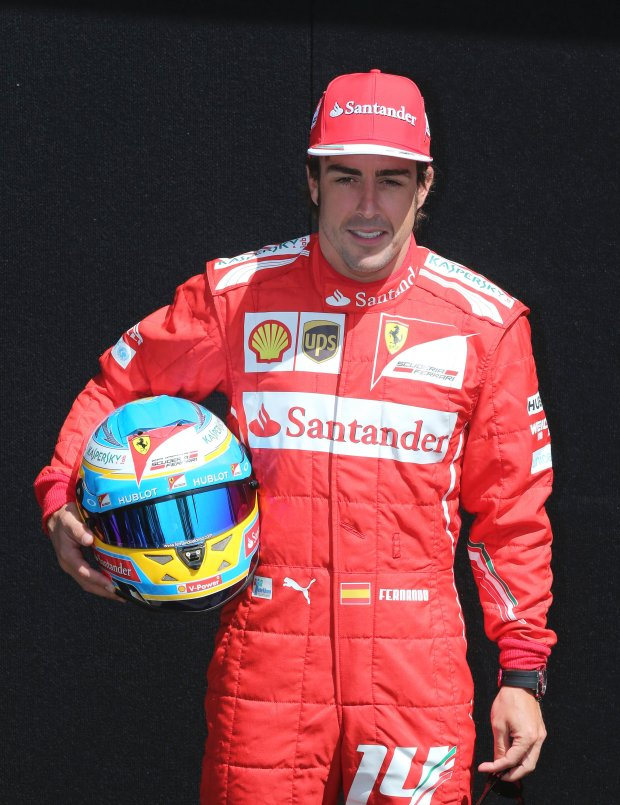 Ferrari driver Fernando Alonso of Spain poses for a photo during the driver portrait session in the paddock ahead of the Australian Formula One Grand Prix at Albert Park in Melbourne, Australia, Thursday, March 13, 2014. (AP Photo/Rob Griffith)