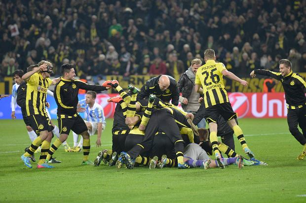Dortmund's players celebrate at the end of the Champions League quarterfinal second leg soccer match between Borussia Dortmund and Malaga CF in Dortmund, Germany, Tuesday, April 9, 2013. (AP Photo/Martin Meissner)