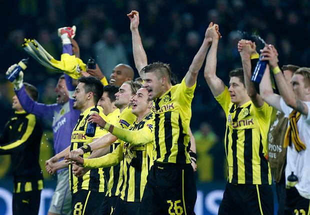 Dortmund players celebrate at the end of the Champions League quarterfinal second leg soccer match between Borussia Dortmund and Malaga CF in Dortmund, Germany, Tuesday, April 9, 2013. Dortmund defeated Malaga 3-2. (AP Photo/Frank Augstein)