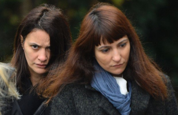 Italian sisters Elisabetta (L) and Francesca Grillo arrive at Isleworth Crown Court in west London November 27, 2013. The two former assistants to celebrity chef Nigella Lawson appeared at court on Wednesday charged with fraud. REUTERS/Toby Melville (BRITAIN - Tags: CRIME LAW ENTERTAINMENT)