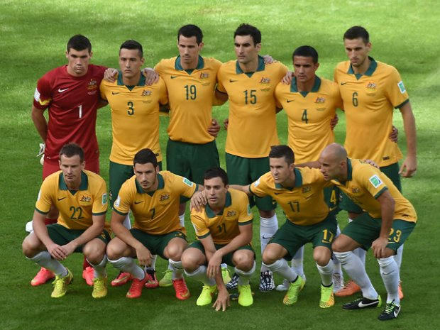 Members of the Australia's national team (back fromL) Australia's goalkeeper Mathew Ryan, Australia's defender Jason Davidson, Australia's defender Ryan McGowan, Australia's midfielder and captain Mile Jedinak, Australia's forward Tim Cahill and Australia's defender Matthew Spiranovic , (front fromL) Australia's defender Alex Wilkinson, Australia's forward Mathew Leckie, Australia's forward Tommy Oar, Australia's midfielder Matt McKay and Australia's midfielder Mark Bresciano pose prior to a Group B football match between Australia and the Netherlands at the Beira-Rio Stadium in Porto Alegre during the 2014 FIFA World Cup on June 18, 2014.    AFP PHOTO/ LUIS ACOSTA        (Photo credit should read LUIS ACOSTA/AFP/Getty Images)