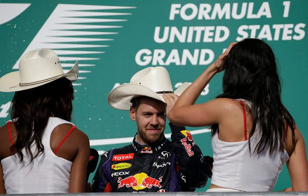 Red Bull driver Sebastian Vettel of Germany tries on a cowboy had after winning the Formula One U.S. Grand Prix auto race at the Circuit of the Americas, Sunday, Nov. 17, 2013, in Austin, Texas. (AP Photo/David J. Phillip)