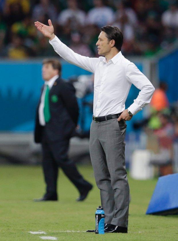 Croatia's coach Niko Kovac gestures during the group A World Cup soccer match between Croatia and Mexico at the Arena Pernambuco in Recife, Brazil, Monday, June 23, 2014. (AP Photo/Petr David Josek)