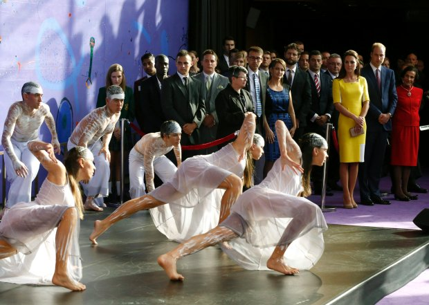 Britain's Prince William, second from right, and his wife Kate, the Duchess of Cambridge, third from right, watch an Aboriginal welcome performance during a reception at the Sydney Opera House Wednesday, April 16, 2014.  The royal couple, along with their son Prince George, are on a 10-day official visit. (AP Photo/Jason Reed, Pool)