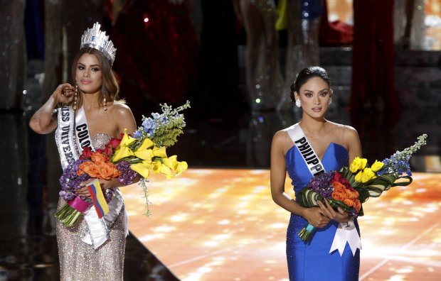 REFILE - ADDITIONAL CAPTION INFORMATIONMiss Philippines Pia Alonzo Wurtzbach (R) waits with Miss Colombia Ariadna Gutierrez onstage, shortly after Miss Colombia was initially crowned Miss Universe during the 2015 Miss Universe Pageant in Las Vegas, Nevada, December 20, 2015. Miss Colombia was announced as the winner but host Steve Harvey said he made a mistake when reading the card. Miss Philippines Pia Alonzo Wurtzbach is the actual winner. REUTERS/Steve Marcus ATTENTION EDITORS - FOR EDITORIAL USE ONLY. NOT FOR SALE FOR MARKETING OR ADVERTISING CAMPAIGNS