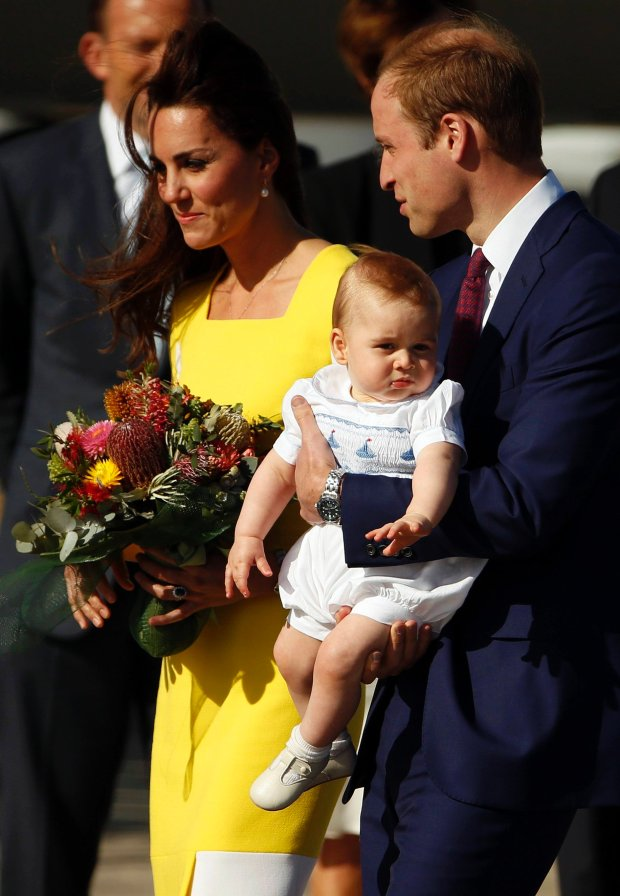 Britain's Prince William carries his son Prince George as he arrives with his wife Catherine, the Duchess of Cambridge, at Sydney airport  April 16, 2014. Britain's Prince William, his wife Kate and their son Prince George flew from New Zealand to Australia, where they will now spend nine-days touring the country.      REUTERS/Phil Noble     (AUSTRALIA - Tags: ROYALS ENTERTAINMENT POLITI  CS)