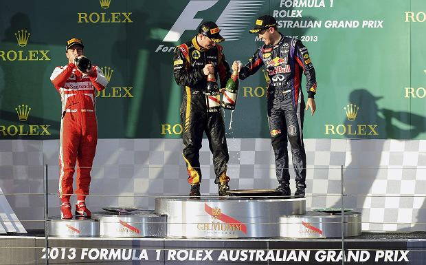 Lotus driver Kimi Raikkonen, center, of Finland, Ferrari's Fernando Alonso, left, of Spain and Red Bull's Sebastian Vettel of Germany celebrate on the podium after the Australian Formula One Grand Prix at Albert Park in Melbourne, Australia, Sunday, March 17, 2013. Raikonen won the race with Alonso second and Vettel third. (AP Photo/Andrew Brownbill)