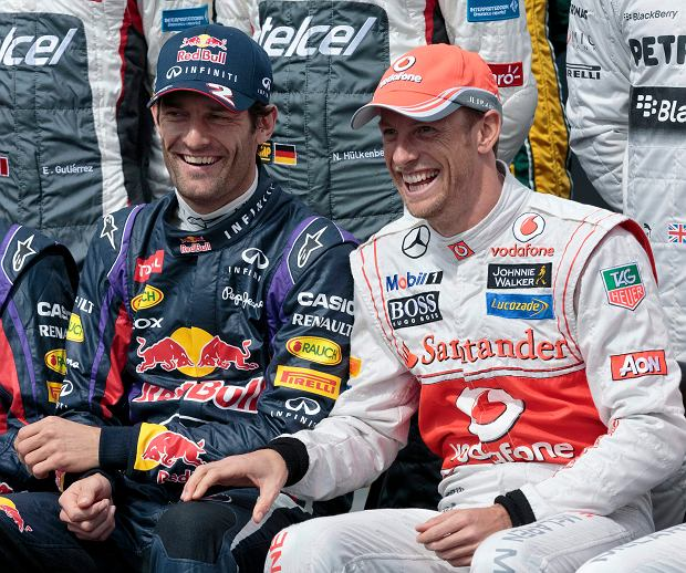 Red Bull driver Mark Webber, of Australia, and McLaren driver Jenson Button, of Britain, laugh during the official driver photo of the Australian Formula One Grand Prix at Albert Park in Melbourne, Australia, Sunday, March 17, 2013. (AP Photo/John Donegan)