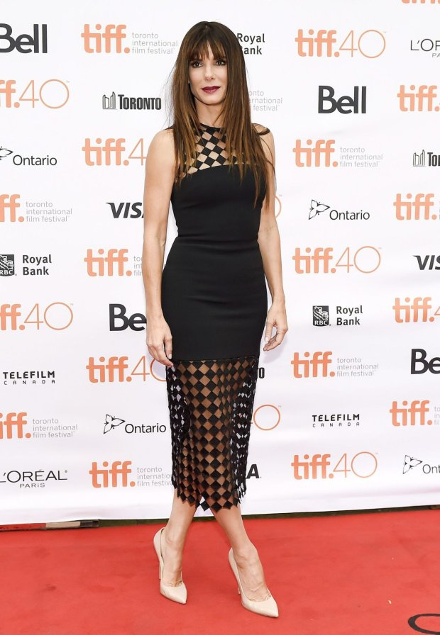 Actress Sandra Bullock poses for photographs on the red carpet for the new movie