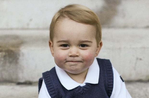 In this photo provided by The Duke and Duchess of Cambridge and taken in late Nov. 2014, Britain's Prince George poses for a photograph in a courtyard at Kensington Palace, London. Great-grandchild to Britain's Queen Elizabeth II,  Prince George was born July 22, 2013, the son of Prince William Duke of Cambridge, and Catherine Duchess of Cambridge, and is third in line to the British throne. (AP Photo/TRH The Duke and Duchess of Cambridge) NO SALES, EDITORIAL USE ONLY