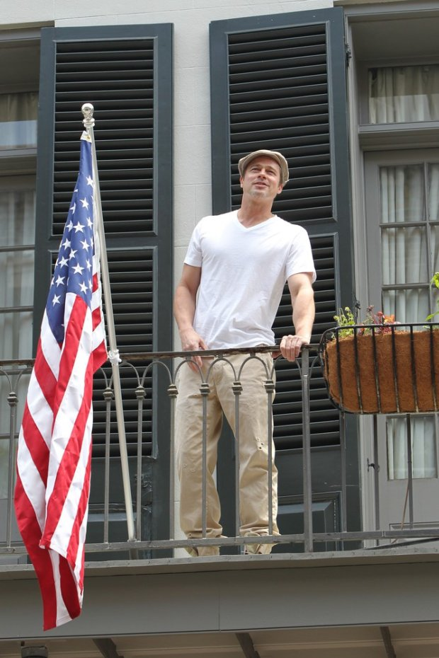 119066, Brad Pitt waves to a crowd from a balcony in the French Quarter, New Orleans. Brad is in New Orleans for his Make It Right Gala this evening and met up with fellow actor Matthew Mcconaughey and football star Drew Brees who are also in town for a charity event . New Orleans, Louisiana - Saturday May 17, 2014. Photograph:  ?? Pacific Coast News. Los Angeles Office: +1 310.822.0419 London Office: +44 208.090.4079 sales@pacificcoastnews.com FEE MUST BE AGREED PRIOR TO USAGE