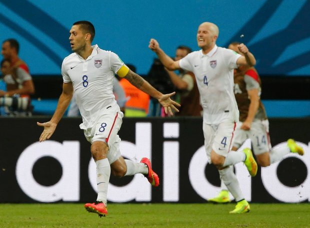Clint Dempsey (L) of the U.S. celebrates with his teammate Michael Bradley after scoring a goal against Portugal during their 2014 World Cup Group G soccer match at the Amazonia arena in Manaus June 22, 2014.      REUTERS/Jorge Silva (BRAZIL  - Tags: SOCCER SPORT WORLD CUP)