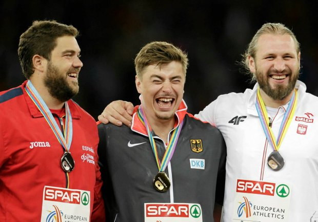 Winner David Storl of Germany, center, silver medal winner Borja Vivas of Spain, left, and bronze medal winner Poland's Tomasz Majewski laugh during the victory ceremony during the European Athletics Championships in Zurich, Switzerland, Tuesday, Aug. 12, 2014. (AP Photo/Petr David Josek)