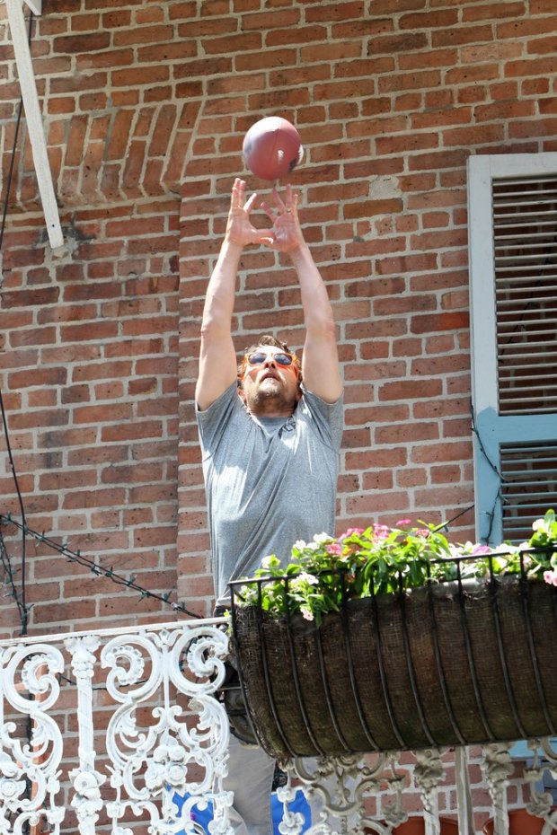 y119068, Matthew McConaughey and his wife Camila Alves bring their children Levi and Vida to participate in his Race for Life event in New Orleans. Also on hand was his mother Kay and his good friend Drew Brees and his wife. Matthews charity event, benefiting his j.k livin foundation involved teams of people running through the citys French Quarter. When they reached Mcconaughey on his balcony, they had to toss him a football. Levi and Vida appeared to be having a great time with their famous dad, wearing beads around their necks. For a short time fellow actor Brad Pitt showed up on an opposite balcony, where Brad threw his friend a drink from one balcony to another. New Orleans, Louisiana - Saturday May 17, 2014. Photograph:  ?? Pacific Coast News. Los Angeles Office: +1 310.822.0419 London Office: +44 208.090.4079 sales@pacificcoastnews.com FEE MUST BE AGREED PRIOR TO USAGE